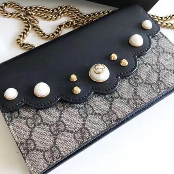 21da62fc5e6 Auth Gucci Peony GG Supreme Pearl Wallet. Gucci.  M_5c70647f2beb793c0806f421. M_5c7063febb7615dc4df80f9d.  M_5c7063ff2e147899c7a67551
